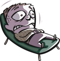 a frightened man lying on a deck chair